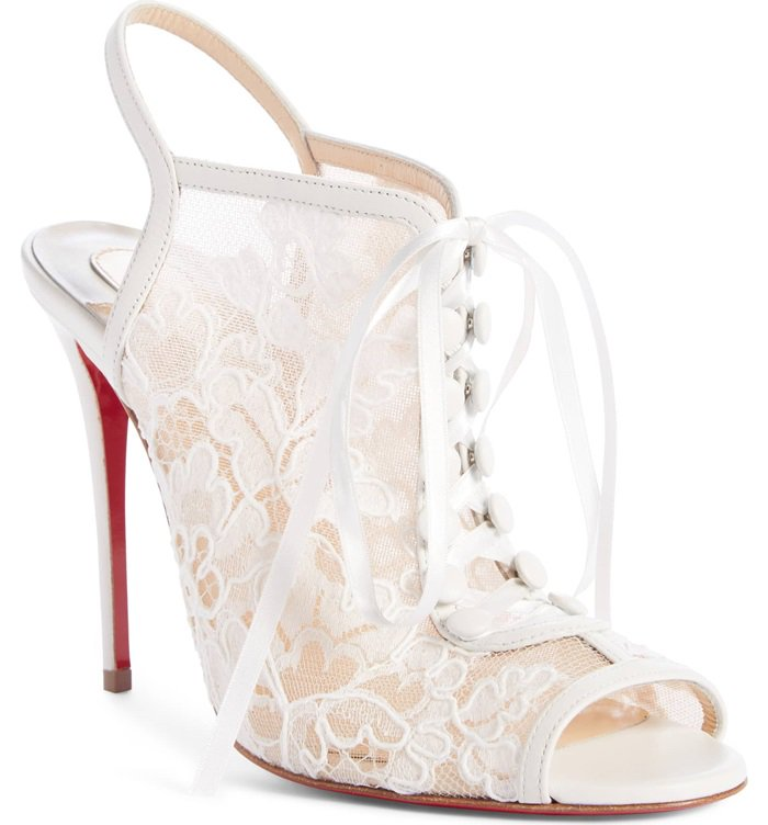 Corset-inspired satin-ribbon lacing and delicate floral lace define a romance-minded sandal lifted by a soaring stiletto