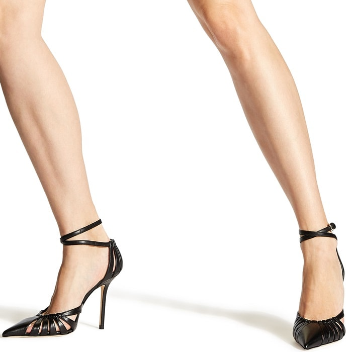 Travis 100 in black metallic nappa is an architecturally powerful pump that semi encloses the toe and heel for a striking effect