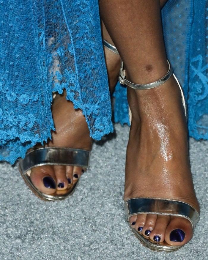Taraji P. Henson showed off her bare feet in metallic Christian Louboutin Loubi Queen sandals