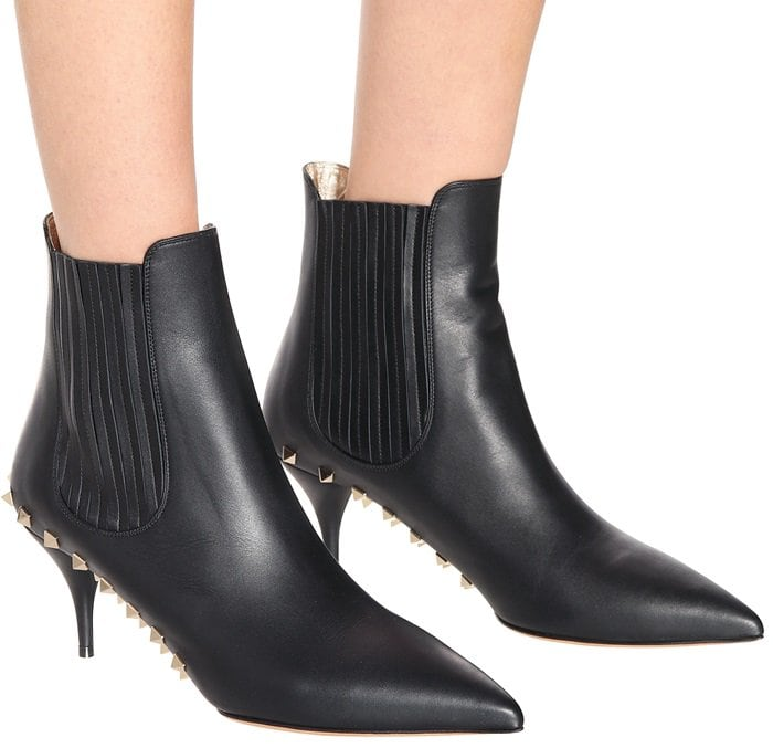 This sleek style has been crafted in Italy from polished black leather with gusseted sides and a slender 70mm heel