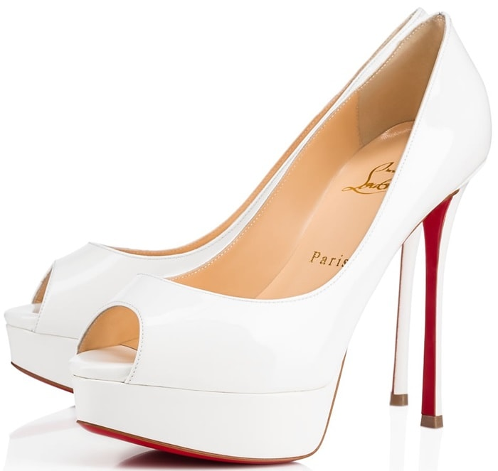 """An alluring update of the signature classic """"Lady Peep,"""" this 130mm peep-toe pump in latte patent leather stands confidently atop a slender fetish heel"""