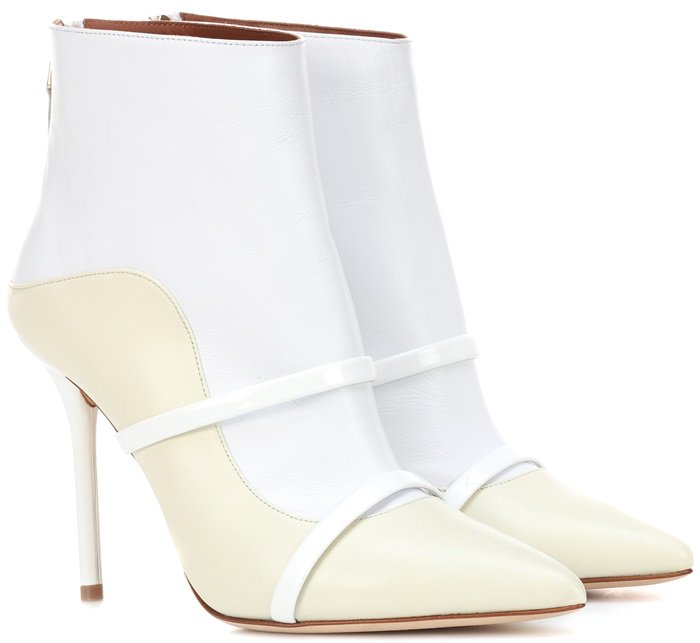 Crafted in Italy from buttery lamb leather, the pointed-toe design features sculptural curves and bands across the vamp