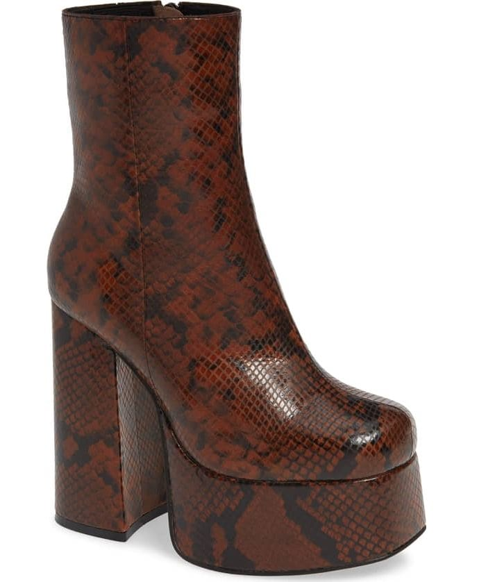 A platform boot with a mile-high heel takes glam rock in a modern direction with sleek styling and an elastic inset at the topline for a custom fit