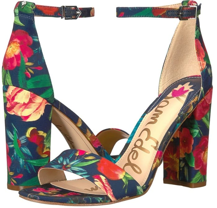 Modern and minimalist, an essential ankle-strap sandal set on a chunky wrapped heel serves as a versatile go-to style