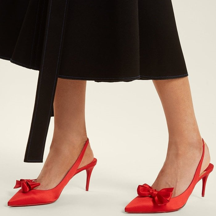 Christian Louboutin's ruby-red Yasling satin pumps are a bold iteration of the season's favoured slingback style with neat bows at the side of each point toe