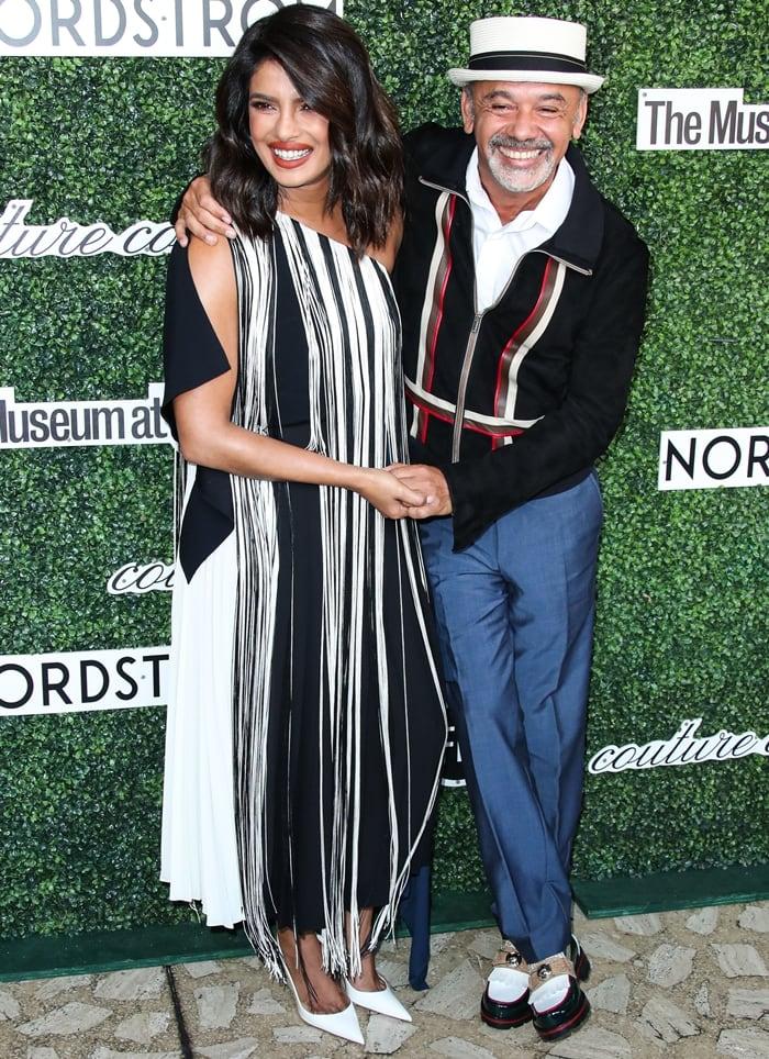 Actress Priyanka Chopra Jonas and French fashion designer Christian Louboutin attending the 2019 Couture Council Award Luncheon