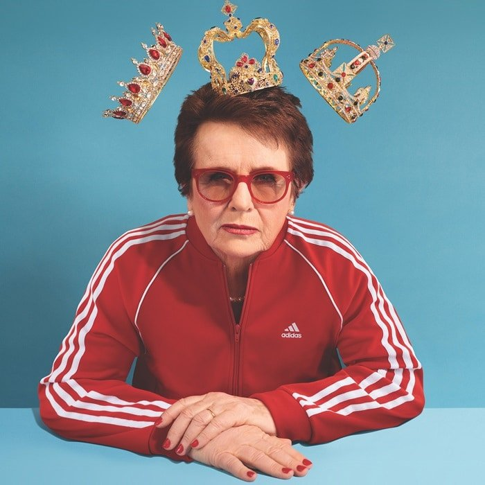 Billie Jean King in a red tracksuit featuring Adidas' mountain logo