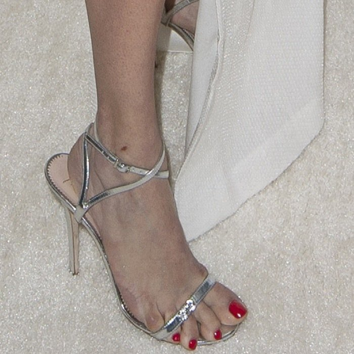 Adriana Lima showed off her monster feet in dual crystal Ellie sandals