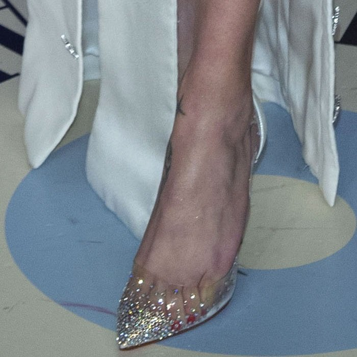Adriana Lima's feet in Christian Louboutin's Degrastrass pumps