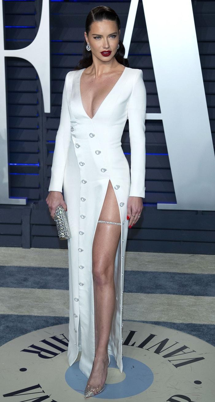 Adriana Lima with a diamond band wrapped around her leg