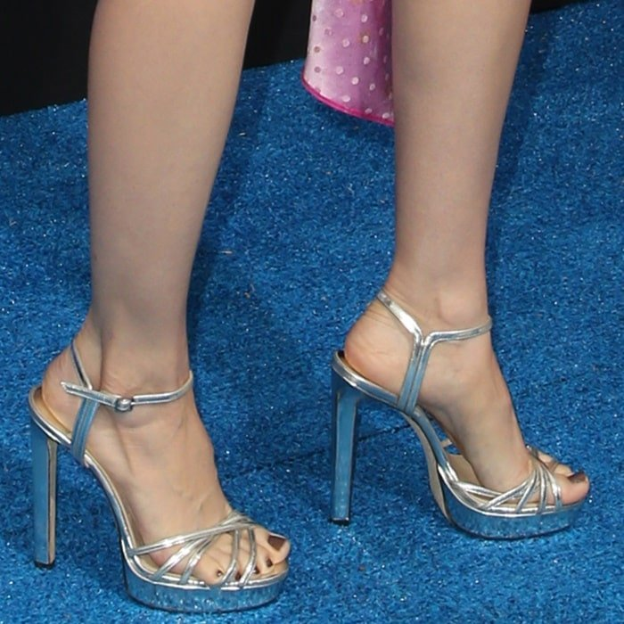 Alison Brie paraded her toned stems in silver sandals by Jimmy Choo