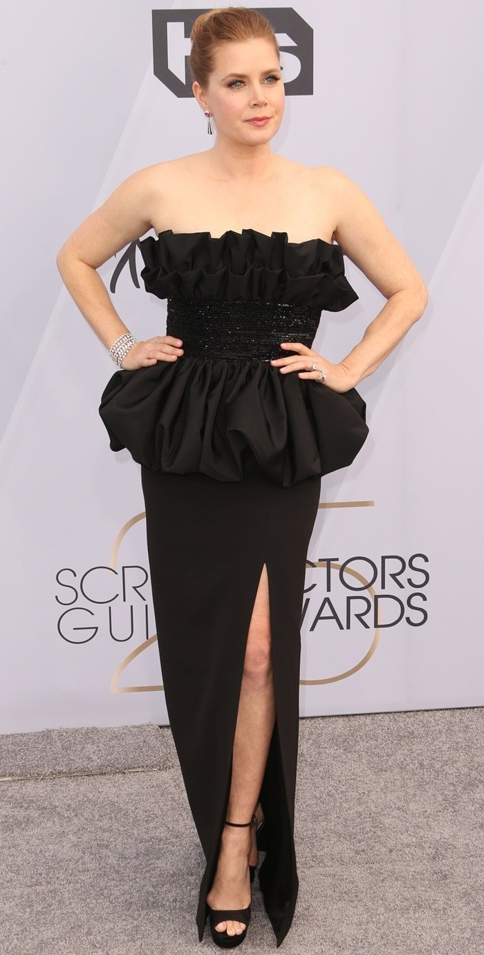 Amy Adams wears a black Celine dress with a high slit at the 2019 Screen Actors Guild Awards held at the Shrine Auditorium in Los Angeles on January 27, 2019
