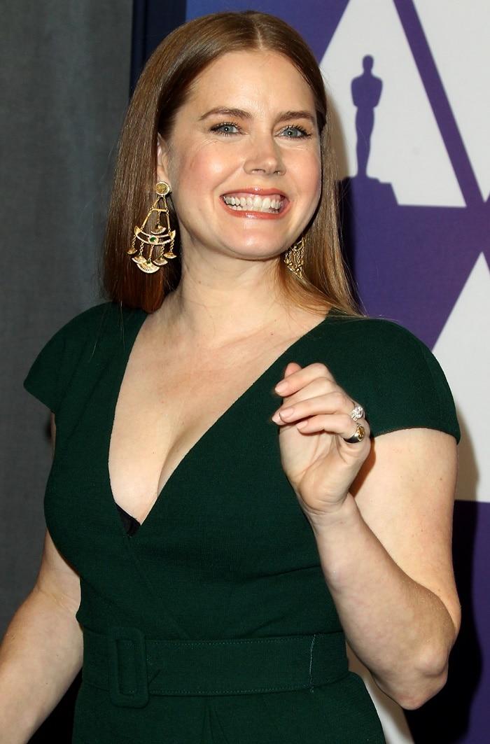Smiling Amy Adams shows off her Azza Fahmy chandelier earrings
