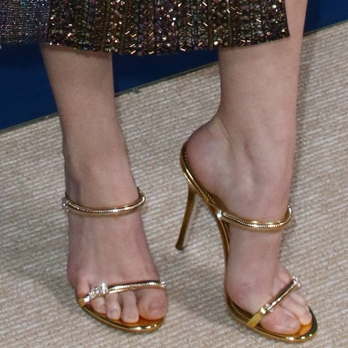 Anna Kendrick's hot feet in gold Darsey Sparkling strappy mules