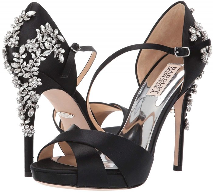 Leafy, crystal-encrusted hardware adds undeniable glamour to this lofty special-occasion sandal