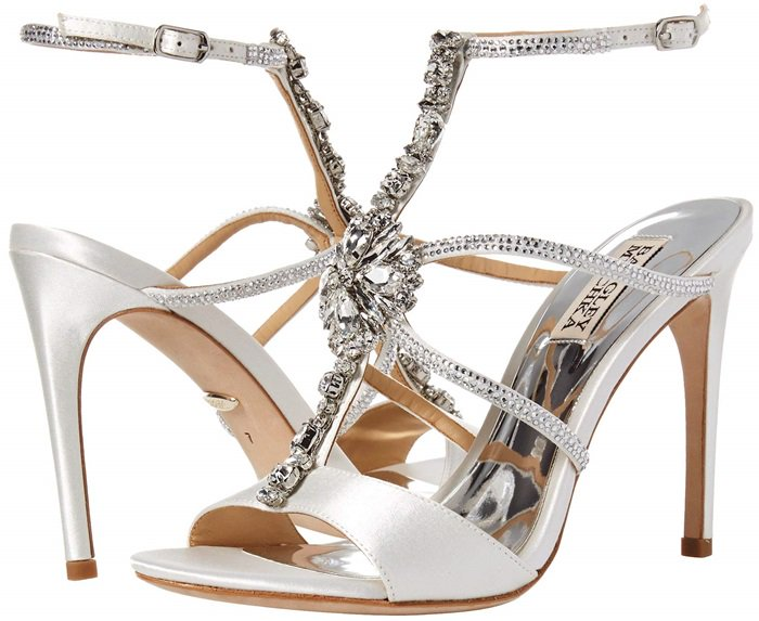 Sparkling, faceted crystals highlight the T-strap style of this lofty stiletto sandal