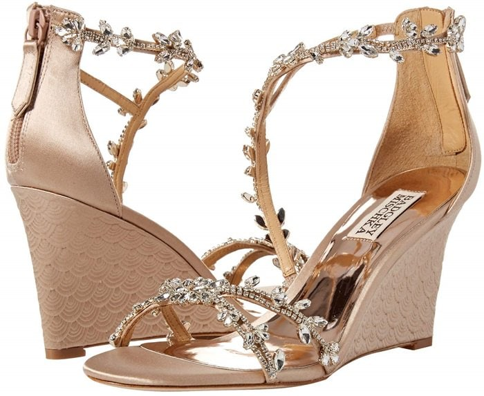 Delicate crystal leaves and feathers trace the asymmetrical straps of an enchanting satin evening sandal.