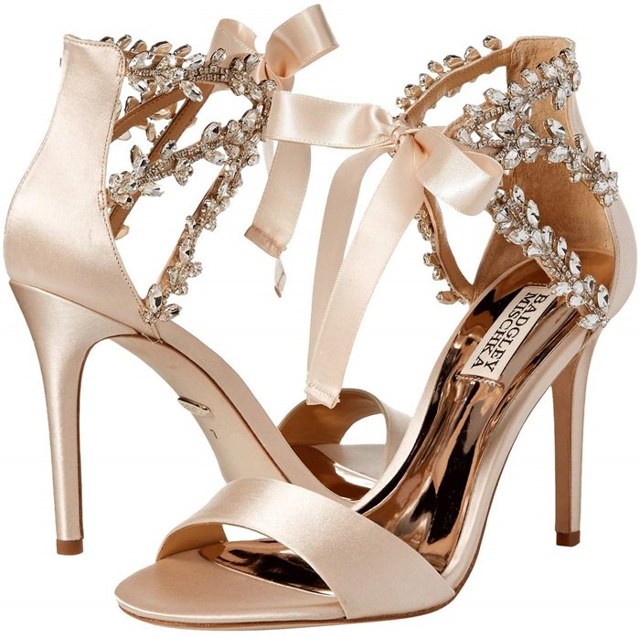 Straps embellished with vines of sparkling crystals illuminate an elegant sandal that's lifted by a svelte stiletto and secured by satin ties at the ankle