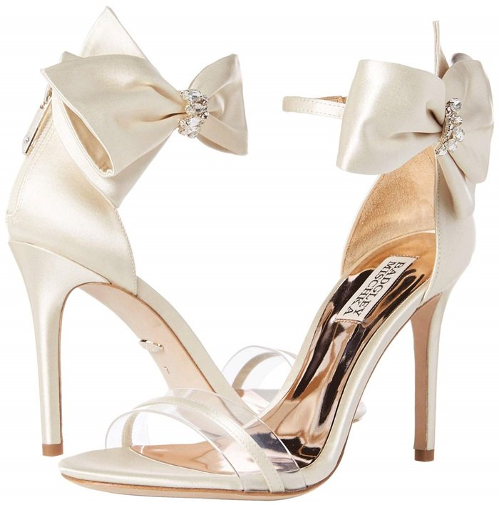 Your competition will be fit to be tied when you steal all eyes in the room with the stunning twist of these heeled sandals featuring a satin upper with a crystal-adorned bow at the ankle