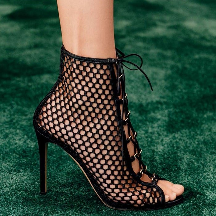 The black mesh wraps around the ankle in a sensual game of hide-and-seek and offers sleek sophistication for a blend of ultra-femininity and glamour