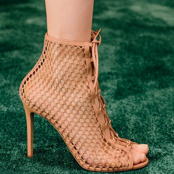 Crochet-inspired patterns and fabrics are key to Gianvito Rossi's new-season footwear offering and this beige leather Cage bootie style is especially striking