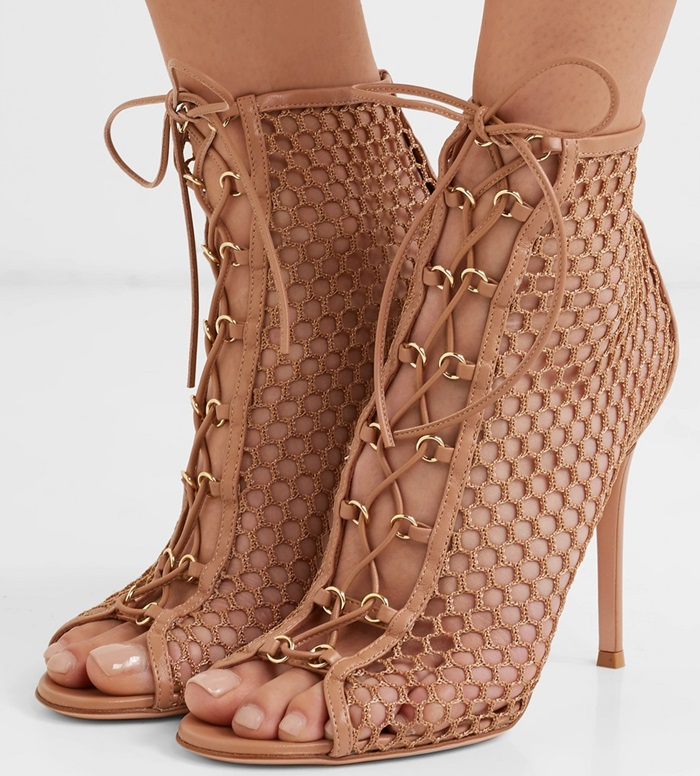 They're crafted with a lace-up front and a high stiletto heel, then finished with a open toe to off-set the barely-there composition