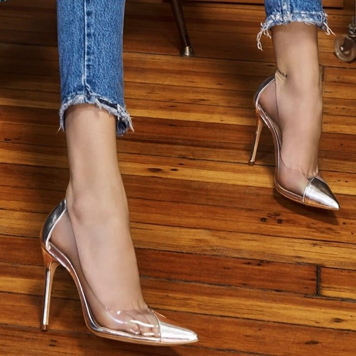 Transparent sides bring a charming glass-slipper aesthetic to a silver pointed cap-toe pump lifted by a slender stiletto