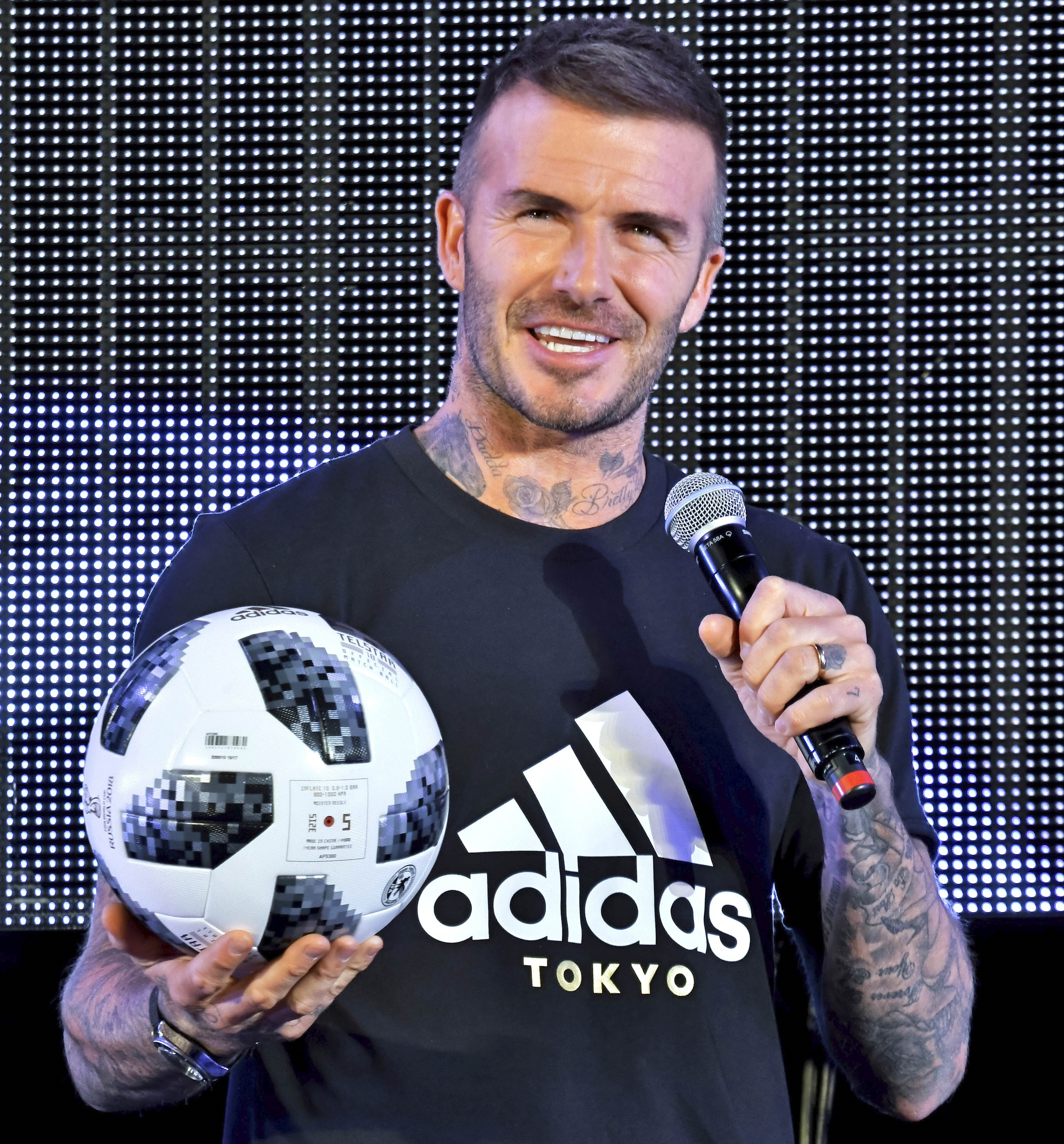 David Beckham showcasing Adidas' triangular mountain logo that represents the challenges athletes face