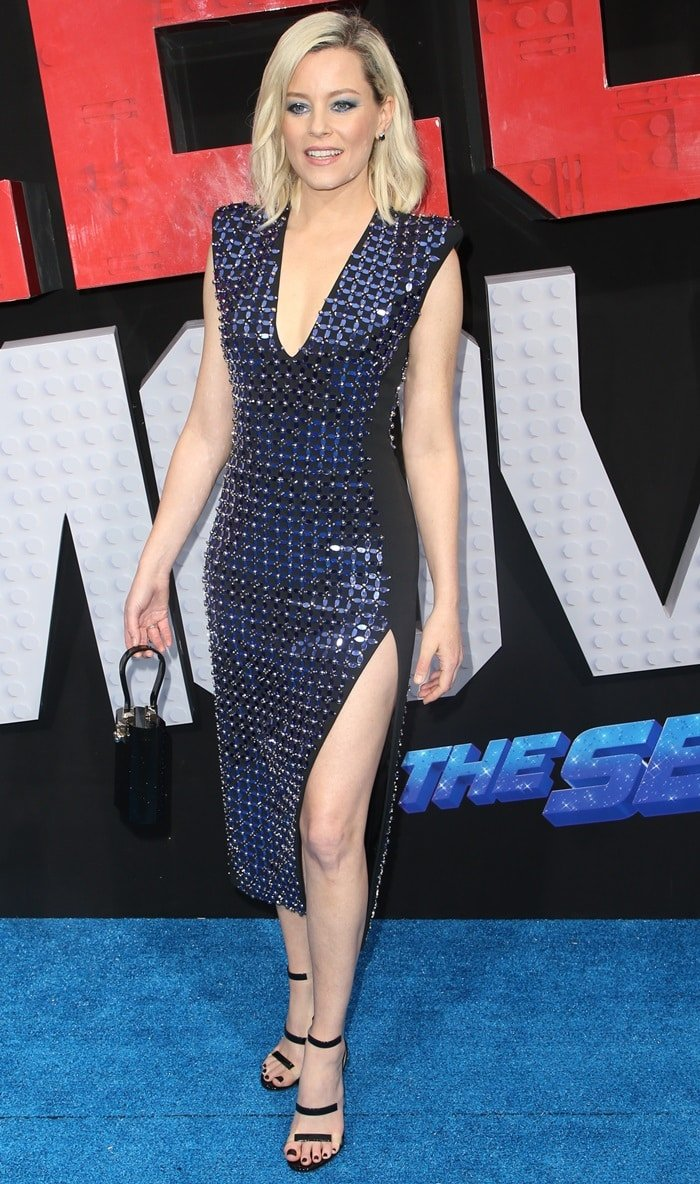 Elizabeth Banks flaunts her bare legs in a David Koma dress