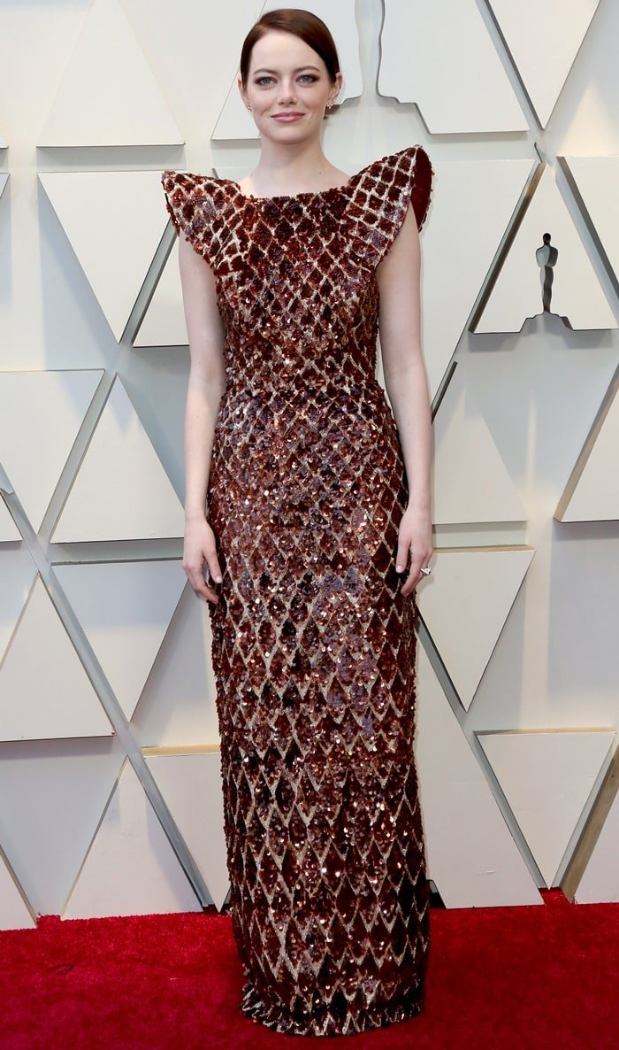 Emma Stone in a gold and brown beehive gown at the 2019 Academy Awards at the Dolby Theatre in Los Angeles on February 24, 2019