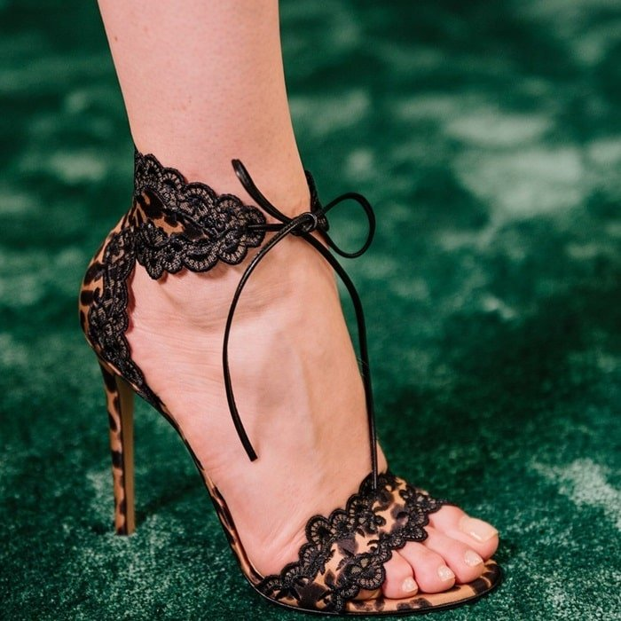 Pretty silk-lace embroidery refreshes these d'Orsay stilettos flaunting a statement leopard print