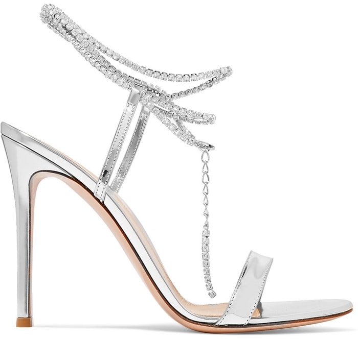 Gianvito Rossi's tennis bracelet sandals are designed with minimal straps, putting the focus on the sparkling Swarovski crystal-embellished chain that drapes elegantly around your ankle