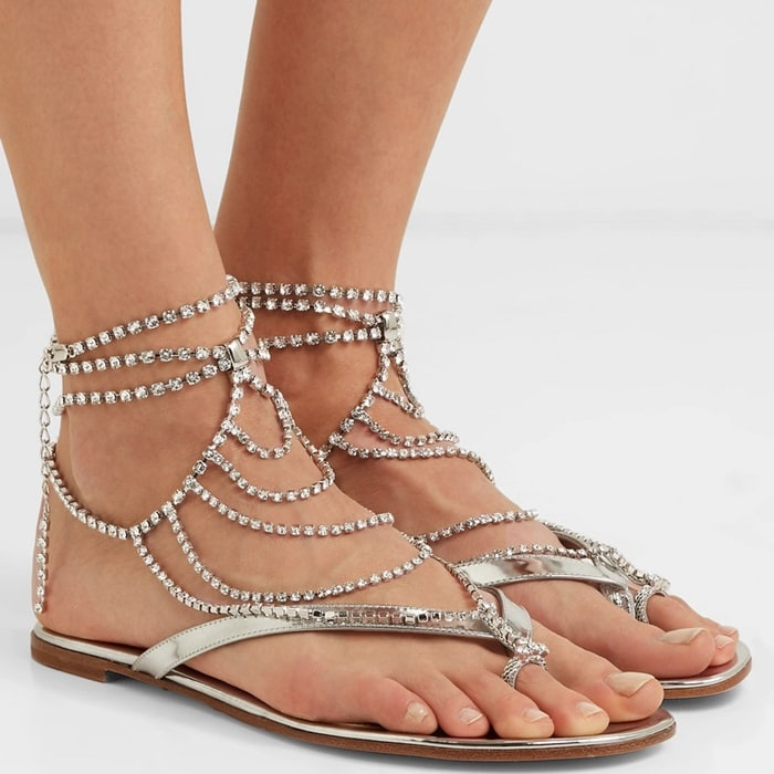 These sandals are made from silver mirrored-leather and come with tiered crystal-encrusted chain anklets that drape languidly to frame your feet