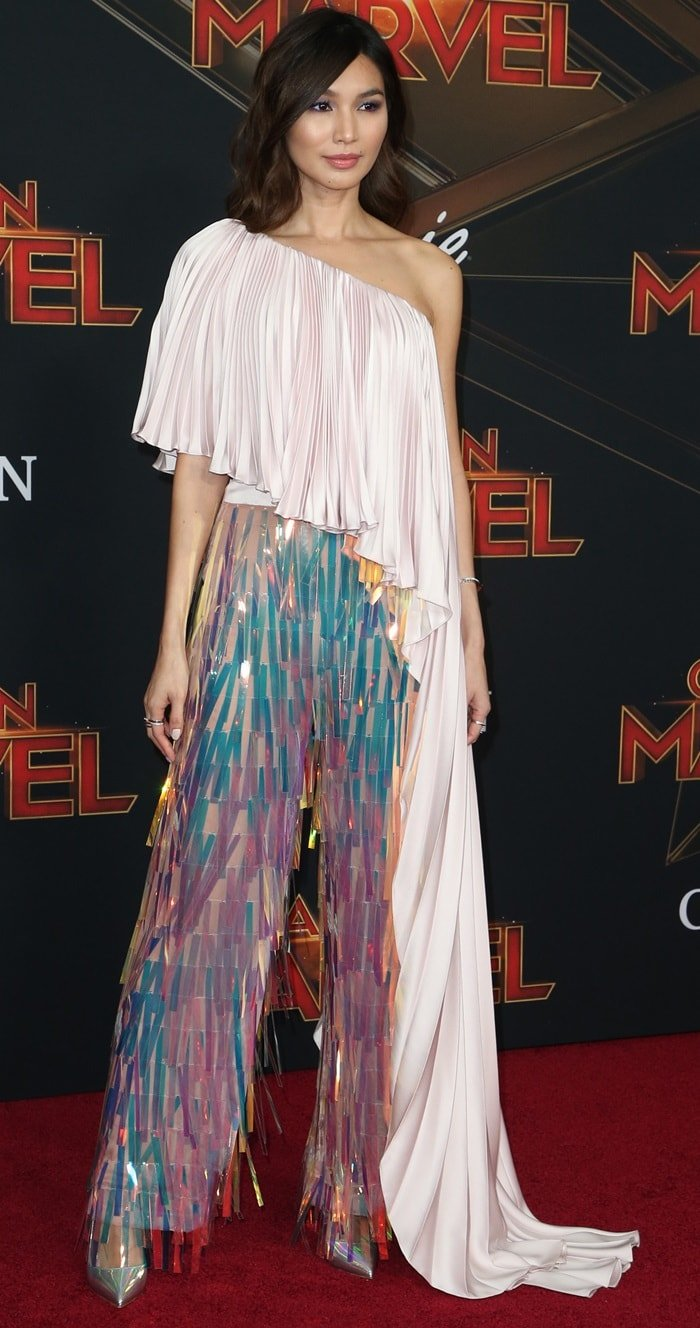 Gemma Chan's asymmetrically draped jumpsuit at the Captain Marvel premiere