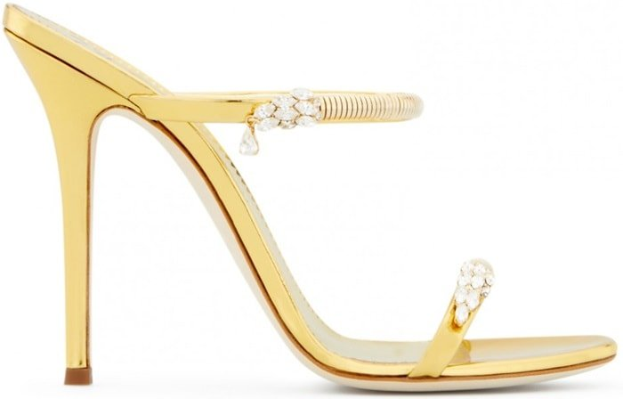 Made from gold shooting patent leather, these sandals are embellished with jewels on the straps