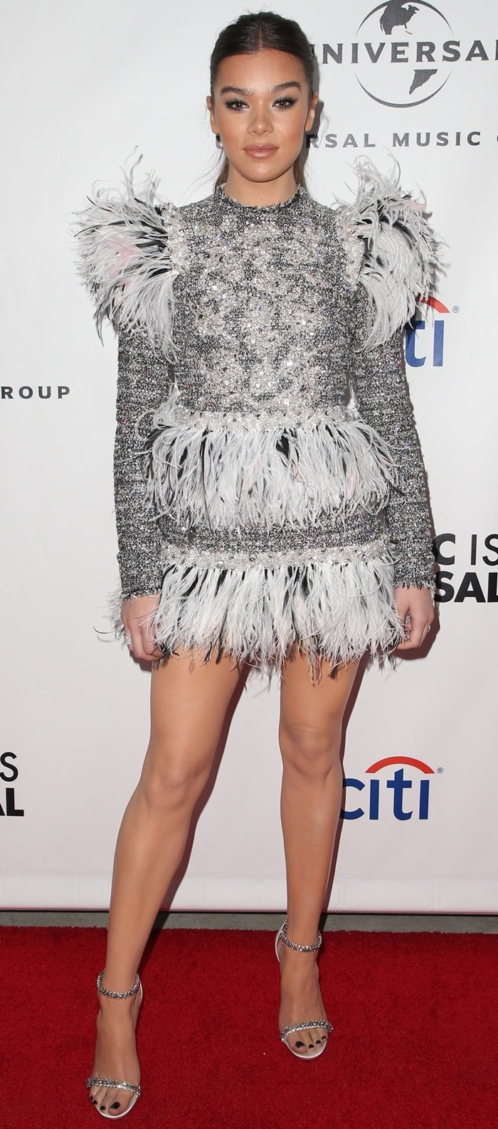 Hailee Steinfeld displayed her nude legs at Universal Music Group's 2019 After Grammys Party in Los Angeles on February 10, 2019