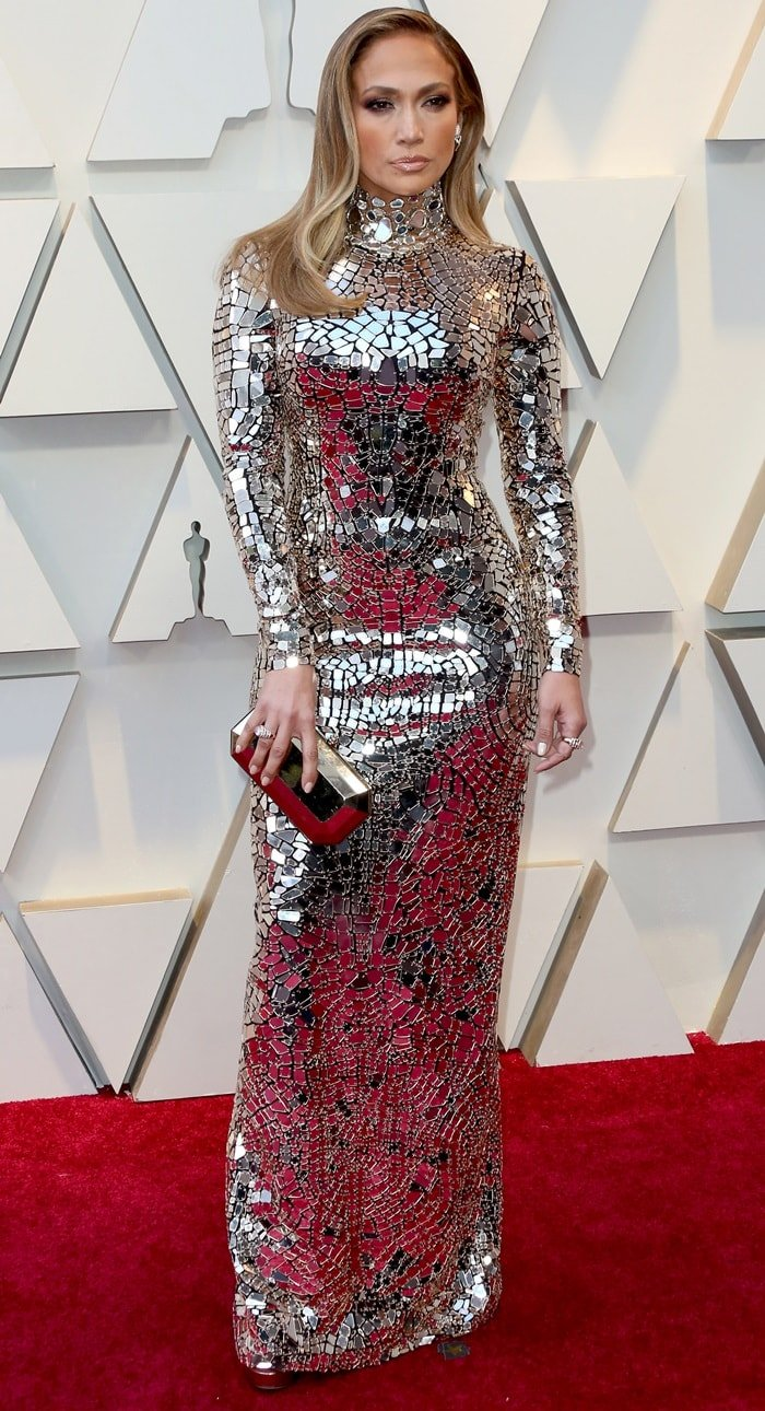 Jennifer Lopez flaunted her hourglass figure in a figure-hugging dress with mosaic mirrored tiles