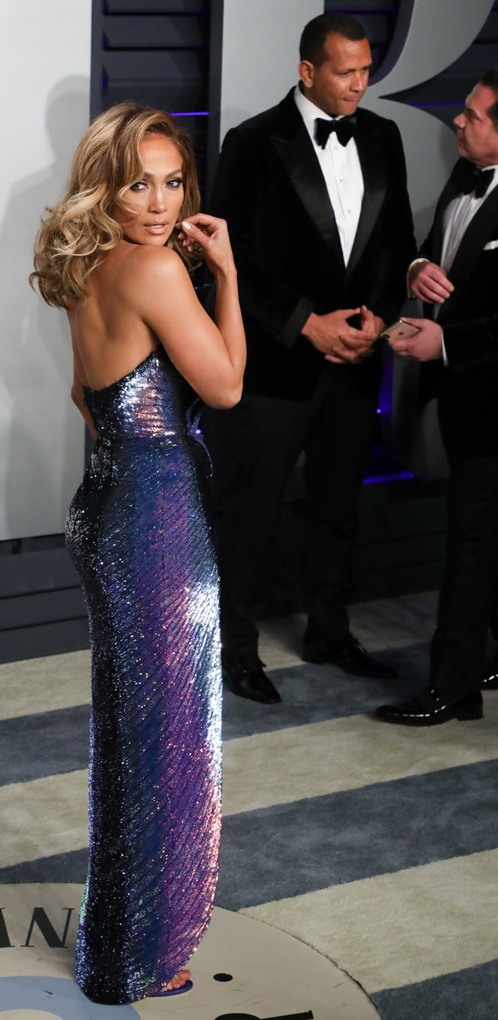 Alex Rodriguez stayed out of the way while Jennifer Lopez came up with silly faces at the 2019 Vanity Fair Oscar Party