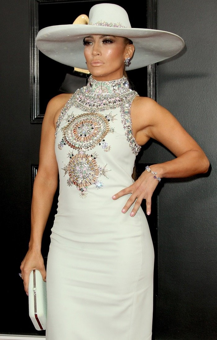 Jennifer Lopez's ridiculously wide-brimmed hat and pale blue sleeveless gown