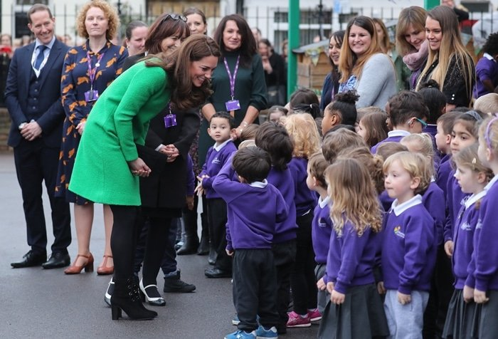 Catherine, Duchess of Cambridge wears L.K. Bennett boots with a green Eponine dress
