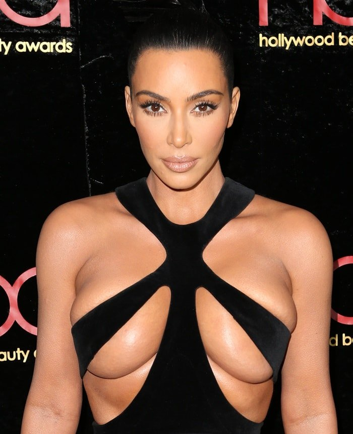 Kim Kardashian barely covered her nipples in a black Thierry Mugler 1998 dress