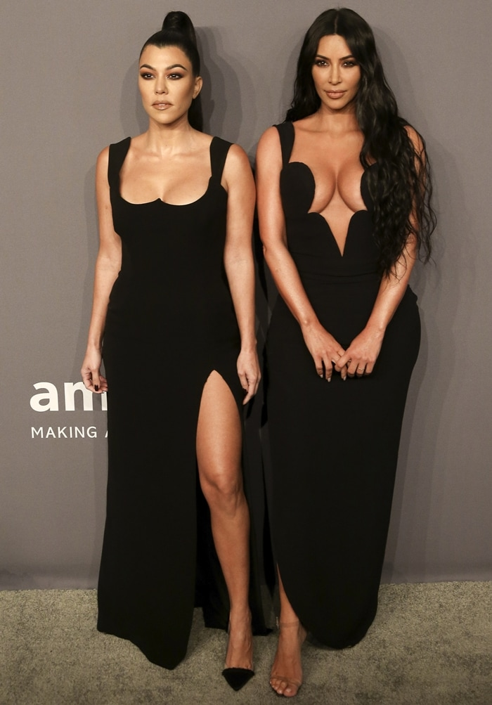 Kourtney Kardashian and Kim Kardashian pose together at the 2019 amfAR New York Gala held at Cipriani Wall Street in New York City on February 6, 2019