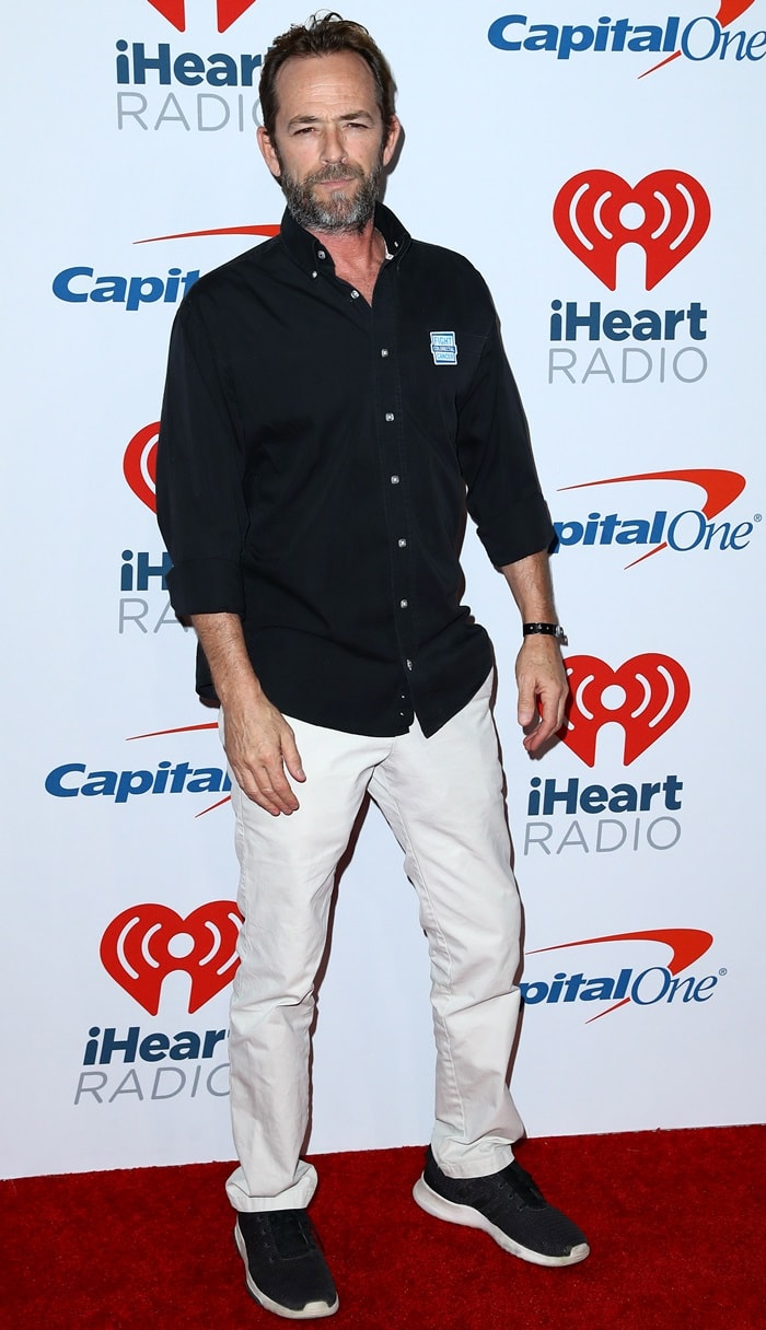 Luke Perry arrives at the iHeartRadio Music Festival at T-Mobile Arena on September 22, 2018, in Las Vegas