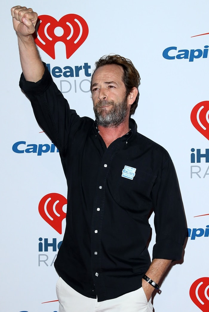 Luke Perry was hospitalized after paramedics responded to his home following a 911 call about a stroke