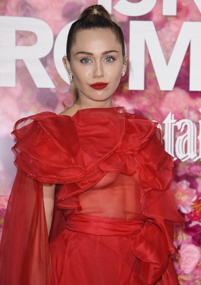 Miley Ray Hemsworth's sleek ponytail and matching red lips