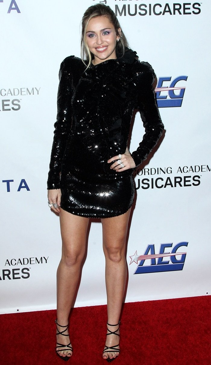 Miley Cyrus paraded her sexy legs in a sequined mini dress