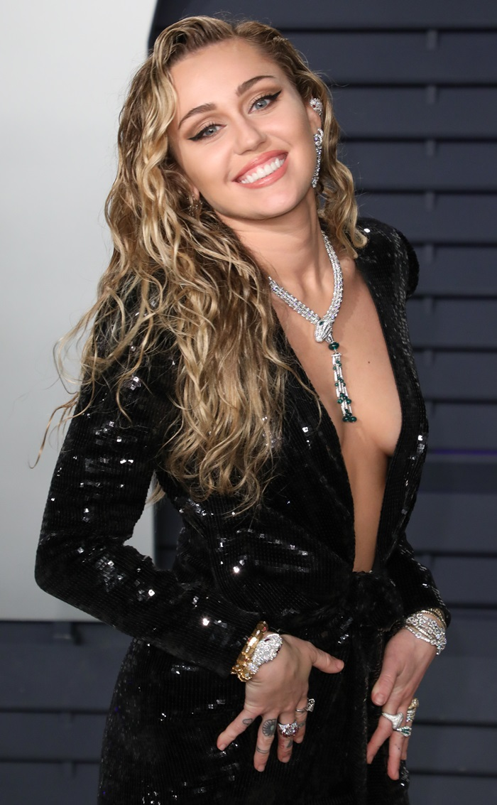 Miley Cyrus flashes sideboob in a dress from Saint Laurent by Anthony Vaccarello