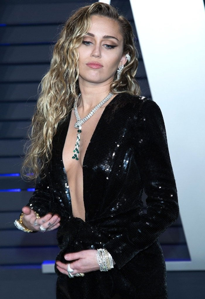 Miley Cyrus could not have worn this dress without a lot of breast tape