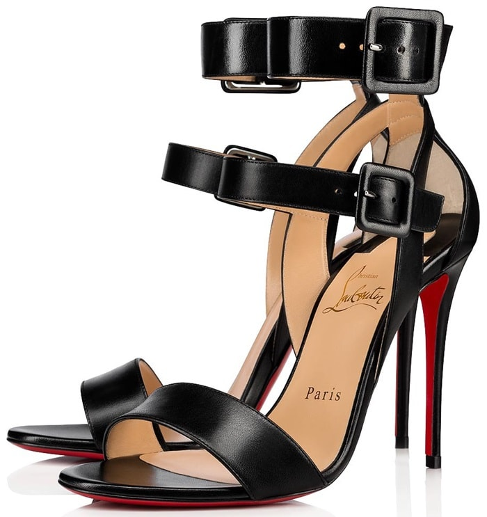 Sleek leather sandals flaunt double buckled ankle straps and the signature red bottoms