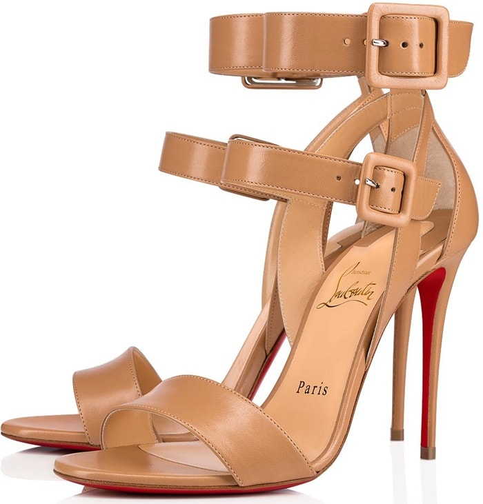 Crafted in nude-colored calfskin, this open toe strappy sandal sports a daringly slimmed down 100mm stiletto